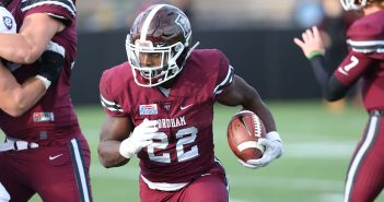 Chase Edmonds, FCRH '18, Fordham football's all-time leading rusher, in a game against Holy Cross