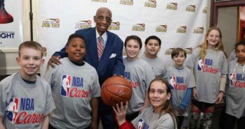 Former New York Knicks star Dick Barnett with young students and athletes at an April 2018 event sponsored by Signature Bank's Scholars Program