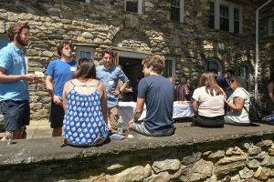 Students mingle on the front porch of Calder Hall