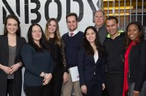 Students in Bernice Grant's Entrepreneurial Law Clinic stand together in Con Body, a boutique gym on the Lower East Side of Manhattan