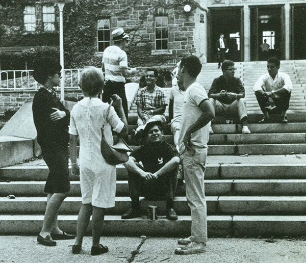 Women and men mingle on the Rose Hill campus, circa mid-1960s