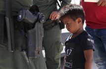 A boy and father from Honduras being taken into custody by United States Border Patrol agents near the Mexico border