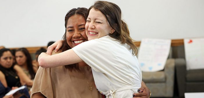 ESl student gets a big hug from her teacher