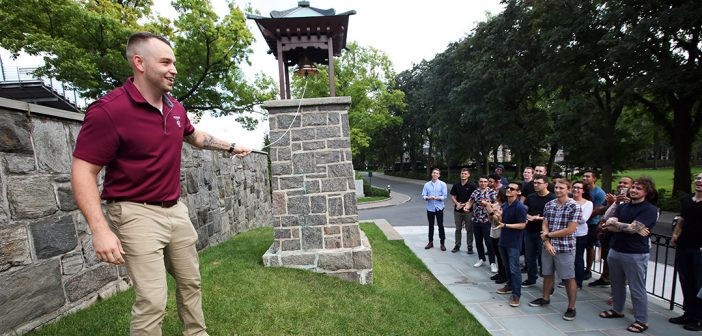 FVA President Wesley Wilson rings the victory bell, welcoming the new veterans to campus.