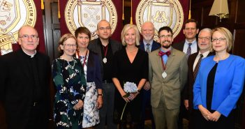 The three new Bepler STEM faculty chairs standing with Kim Bepler, Father McShane, Fordham deans, and administration
