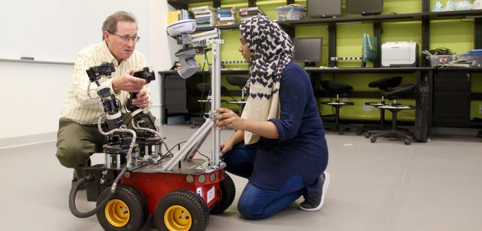 Damian Lyons, Director of Fordham's Robotics and Computer Vision Laboratory, works with his graduate research assistant, Saba Zahra.