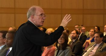 Father McShane addresses a crowd at Fordham Law