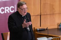 Cardinal Joseph Tobin, archbishop of Newark speaking at a podium at the McNally Ampitheatre
