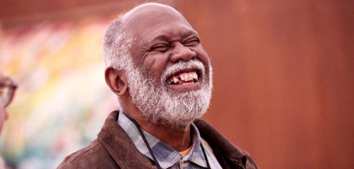 Emeritus Associate Professor smiles