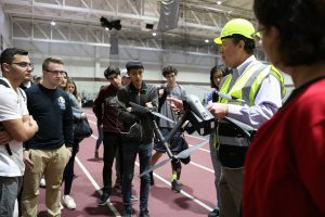 Kevin Meenan shows Gabelli School students a DJI Inspire 2 drone before demonstrating how it flies.