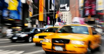 New York City taxi drives through Times Square