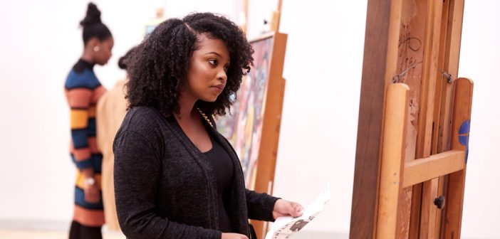 An attendee looks at Brown's art