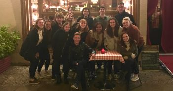 The Berlin students pose for a group picture with their professor in front of a restaurant in Germany.