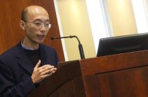 Weiping Zheng, an epistemologist from Xiamen University, speaks about the rules behind making assertions, behind a podium at the front of the room.