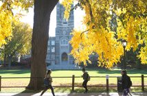 Keating Hall as seen through trees with leaves turning yellow