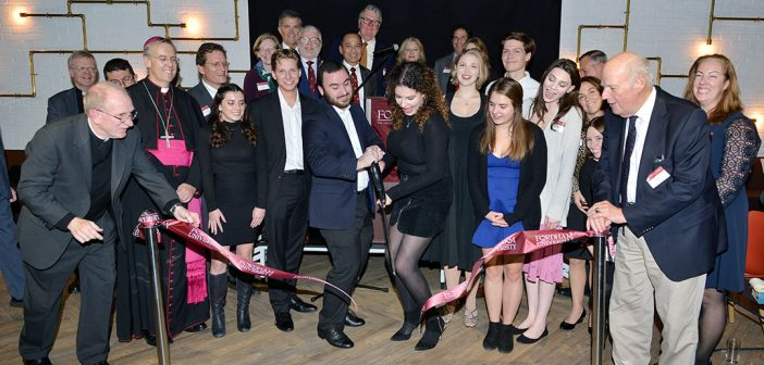 Students, faculty, and adminstrators laugh and smile at ribbon cutting for London Centre
