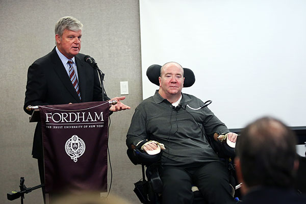 James J. Houlihan introduces his friend Billy Keenan at Fordham's Westchester campus.