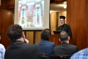 Bishop Irinej, Bishop of the Serbian Orthodox Diocese of Eastern America, speaking at the podium at the 12th floor lounge.