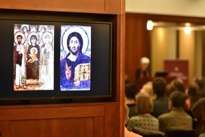 Byzantine art projected onto a screen in the 12th floor lounge