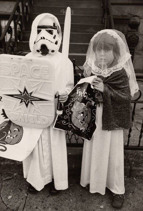 Two kids dressed for Halloween as a space warrior and a bride