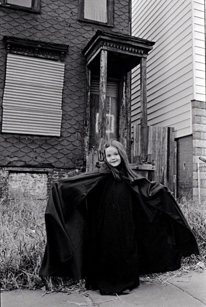 A young girl dressed up as a witch for Halloween