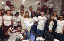 "Students wearing ""#FORDHAMGIVES"" t-shirts at last year's Giving Day"