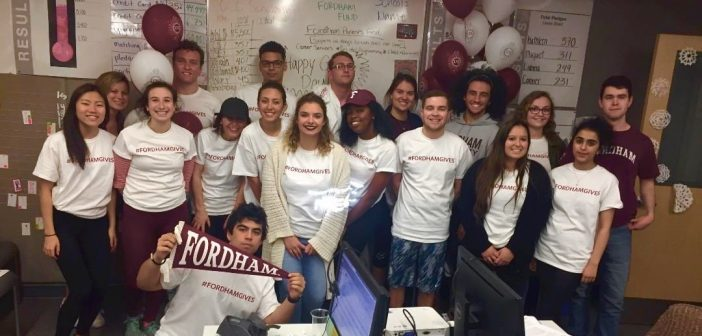 "Students wearing ""#FORDHAMGIVES"" t-shirts at last year's Giving Day"