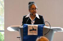 Tanya Hernandez speaking at a podium at Fordham Law
