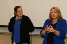 Anne Fernald and Debra McFee address a crowd in the South Lounge in the Lincoln Center campus