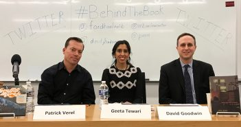 Patrick Verel, Geeta Tewari and David Goodwin sit at a table at Fordham School of Law
