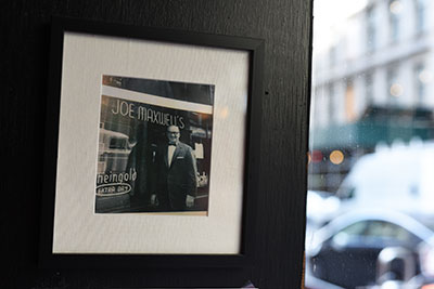 A photo of Joe Maxwell, the owner of the original Joe Maxwell's, hangs inside the restaurant.