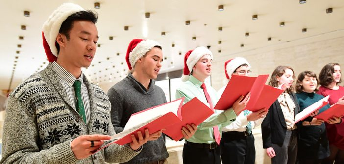 Fordham chioir singing outside Koch Theater at Lincoln Center at President's Club Christmas Reception 2018
