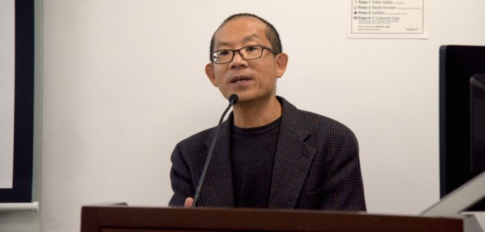 Eric Chen addresses the audience at the podium.