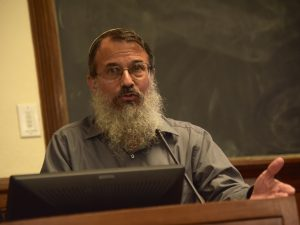 Rabbi Hanan Schlesinger speaks from the podium