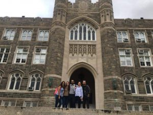 Italian exchange students stand on the steps of Keating Terrace