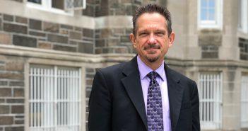 Kirk Bingaman standing in front of Keating Hall
