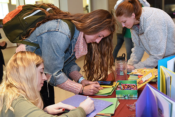 Fordham students make get-well cards for patients at St. Jude's Children's Research Hospital.