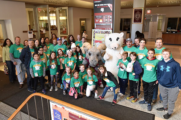 Several dozen kids and parents participated in Make a Difference with Loukoumi Day at Fordham in November 2018.