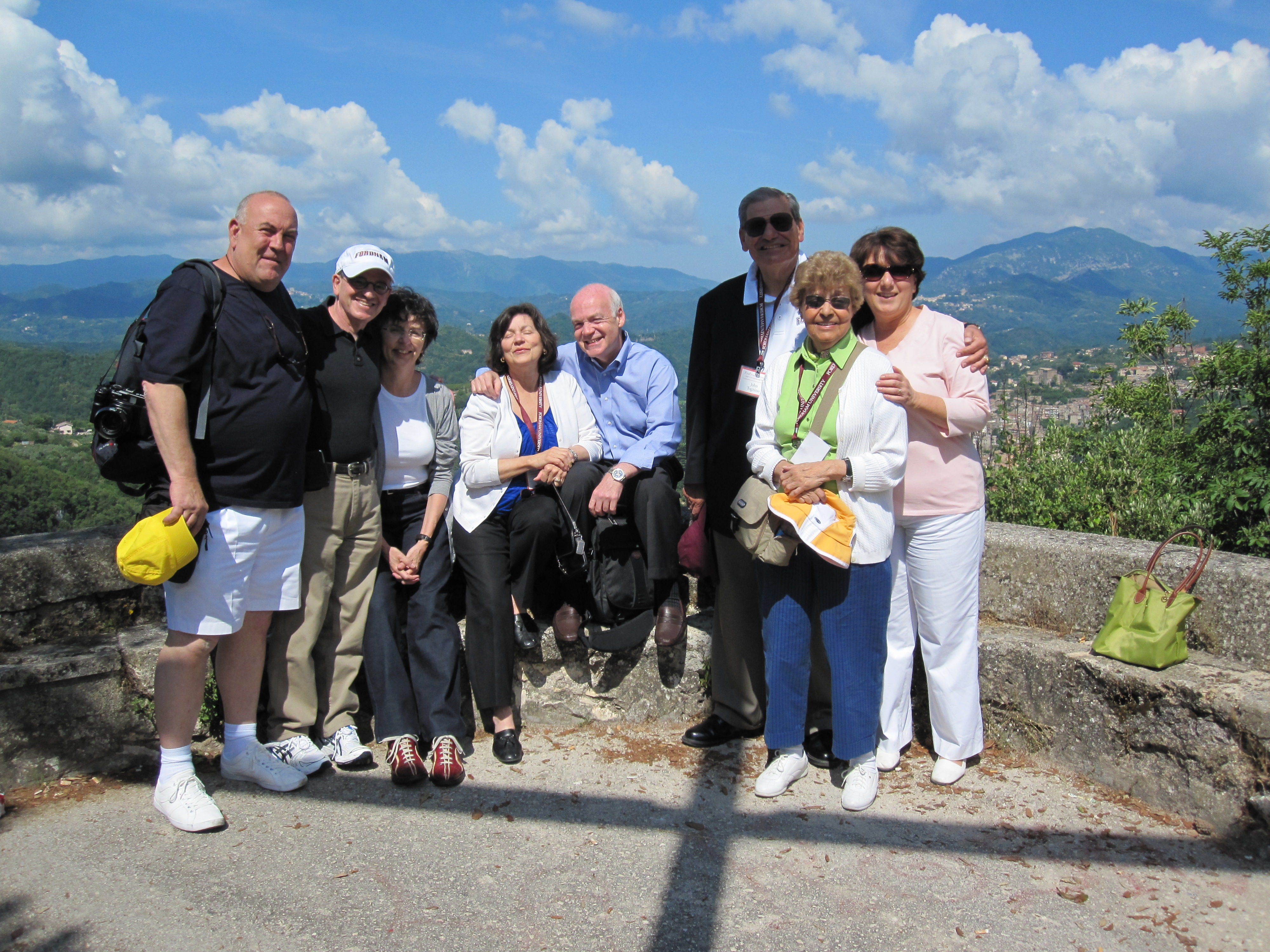 The Togninos on a 2009 Fordham trustees trip to Italy, with a group, atop a mountain
