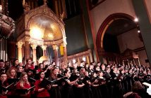 Fordham choral groups singing under gold dome in St. Paul church