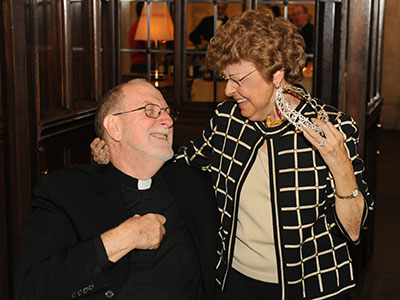 Norma with Father Patrick Ryan at the Togninos 50th anniversary celebration