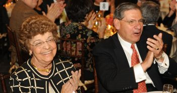 Togninos at 50th anniversary celebration, clapping