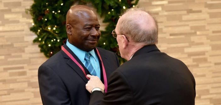 Father McShane speaks up-close and personal with one of the awardees.