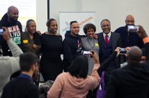 Leaders from South Bronx nonprofits with Professor Mark Chapman at a Martin Luther King Jr Day event at Rose Hill, posing for photos