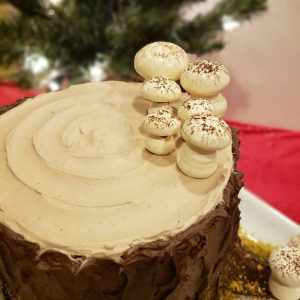 A Yule stump chocolate sponge cake that Tina baked for her Fordham colleagues last Christmas. The cake is filled with white chocolate mousse, covered with chocolate buttercream, and garnished with meringue mushrooms.