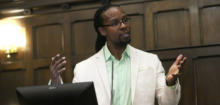 Ibram Kendi, Ph.D., speaks from behind a podium at Tognino Hall
