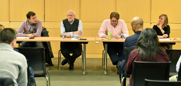 Michael Pirson, David Gautschi, Paul Johnson, and Julita Haber seated at a table at Fordham Law School