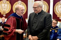 Father McShane giving Father Lombardi his medal