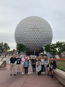 Gabelli students standing in front of the Epcot's Spaceship Earth ride