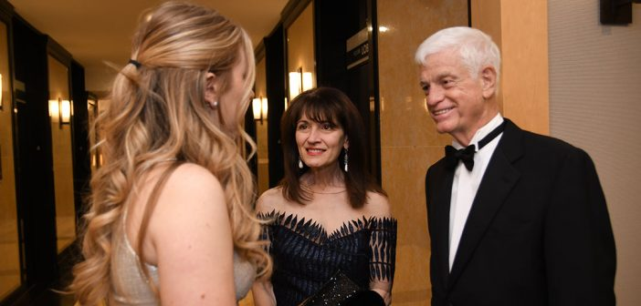 Regina Pitaro and Mario Gabelli chat with a scholar